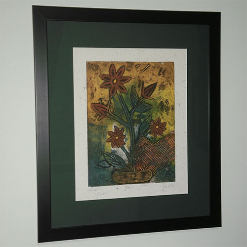 Flower print in black frame and dark green mount