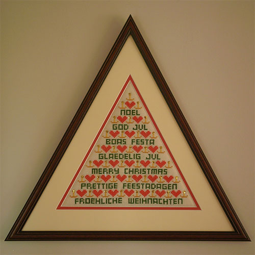 triangular frame with tapestry
